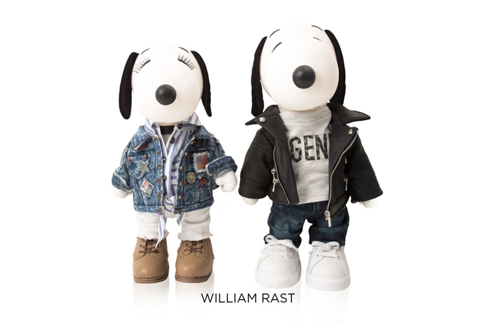 Two black and white, stuffed toy dogs standing in front of a white background. The one on the left is wearing a jean jacket and brown shoes and the other one is wearing a black leather jacket, jeans and white sneakers.