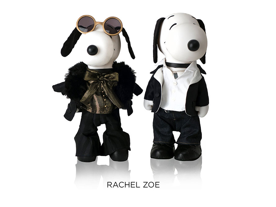 Two black and white dogs statues in front of a white background. The dog on the left is wearing sunglasses and a fur coat and the dog on the right is wearing a white collar shirt, jeans and a black sweater.