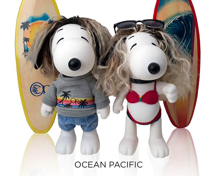 Two black and white dog statues in front of surfboards and a white background.